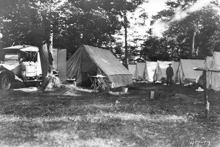 Roughing It, 1919. Each camper had his own tent with cots and mattresses.