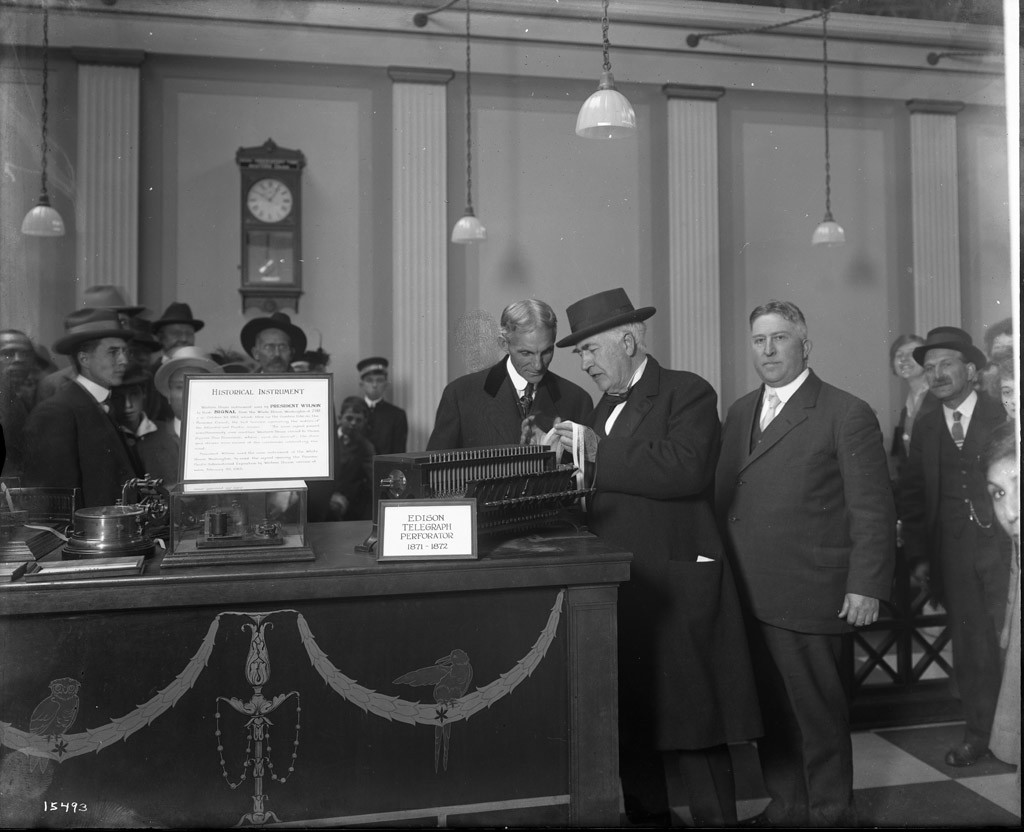 Thomas Edison and Henry Ford looking at an Edison Telegraph at the Western Union Exhibit, Liberal Arts Palace, Panama-Pacific International Exposition, 1915; Courtesy Special Collections, University of California, Davis
