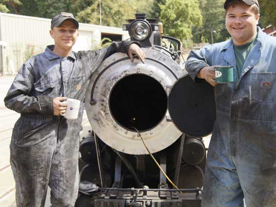 Volunteers at Swanton Pacific Railroad maintaining the #1914 Overfair Railway locomotive