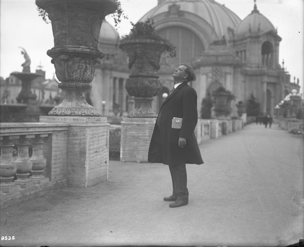 Man looking at Panama Pacific International Exposition grounds, 1915. Courtesy UC Davis Library.